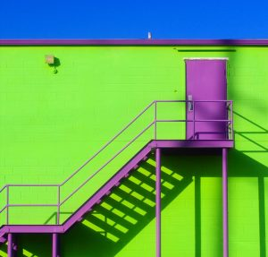 Green wall with purple stairs