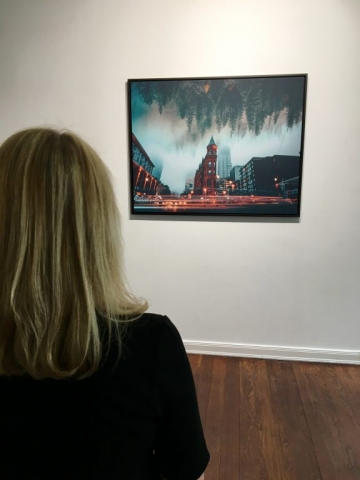 person in front of framed canva photo