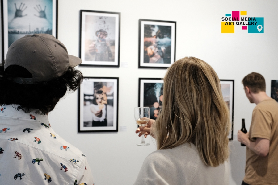 People viewing framed photos of cinnaavox