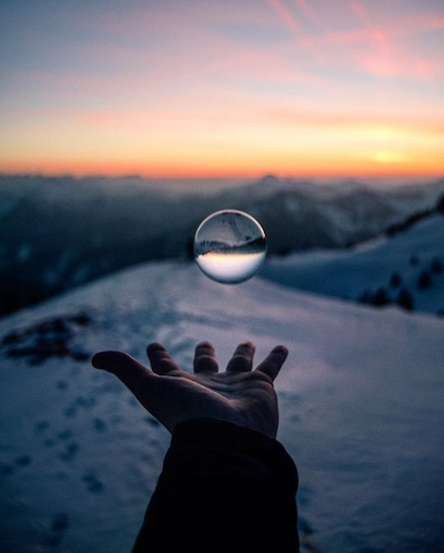 Hand with crystal ball in winter