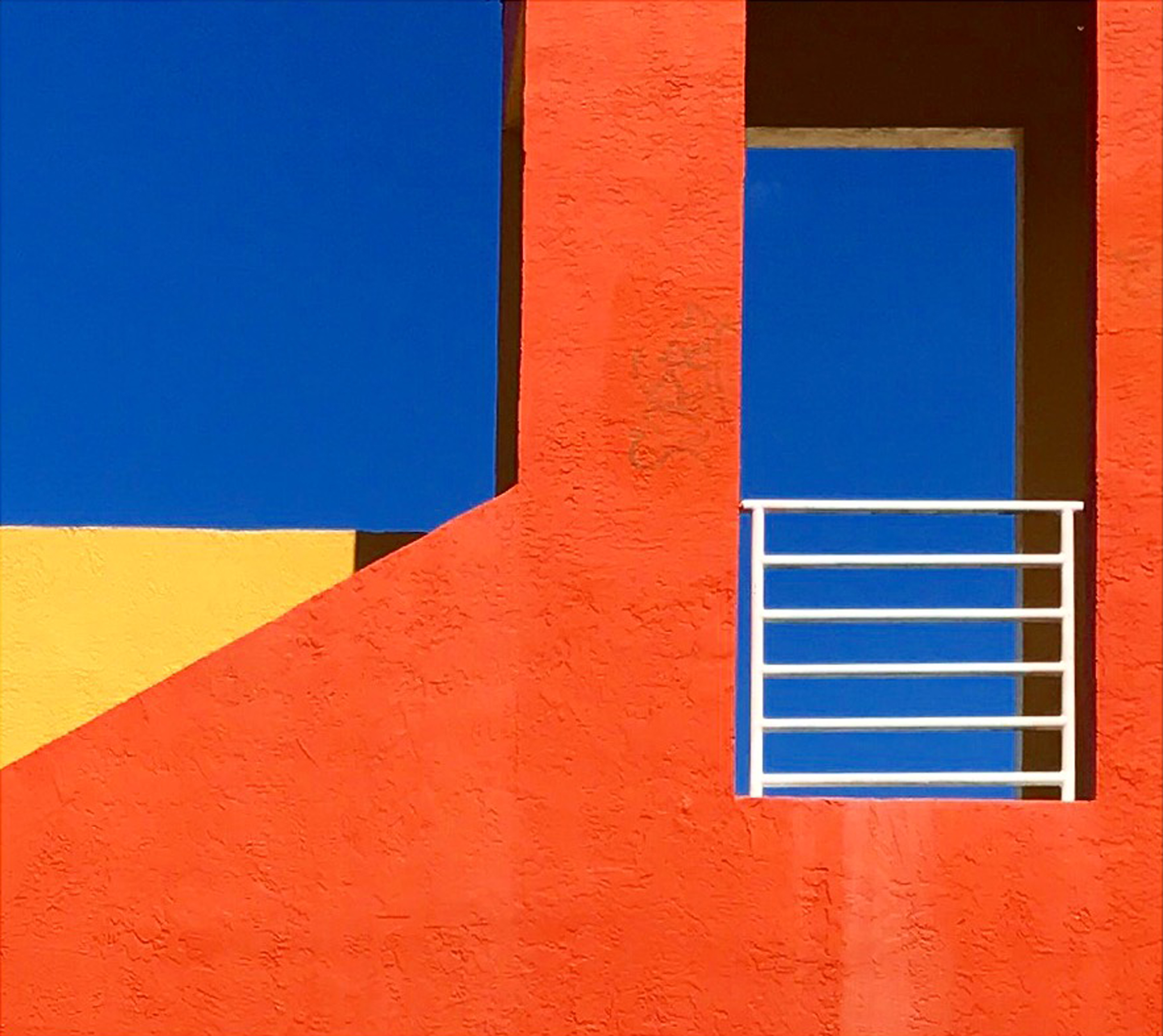 Orange yellow building in florida with blue sky