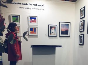 woman viewing booth of social media art gallery