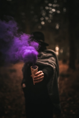 Woman holding ice cream with purple smoke