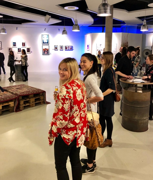 happy guests at the event of social media art gallery