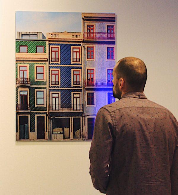 Art buyer viewing artwork by konaction