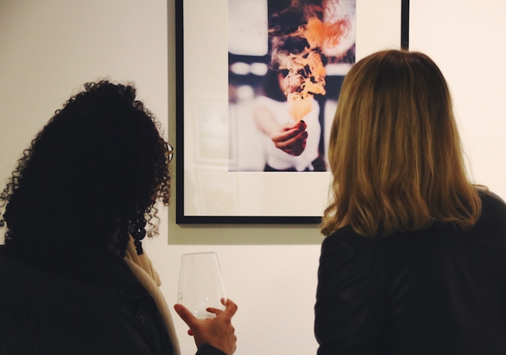 Art buyer viewing artwork