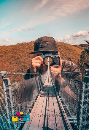 photo of a photographer on a bridge