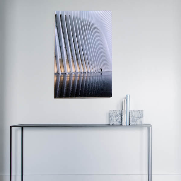 acrylic glass photo hanging on wall with sideboard