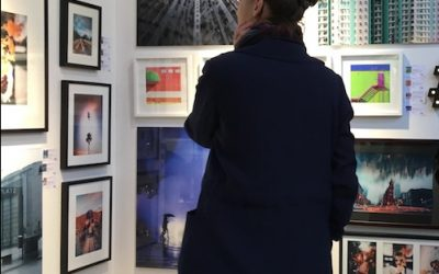 woman looking at photography of social media art gallery