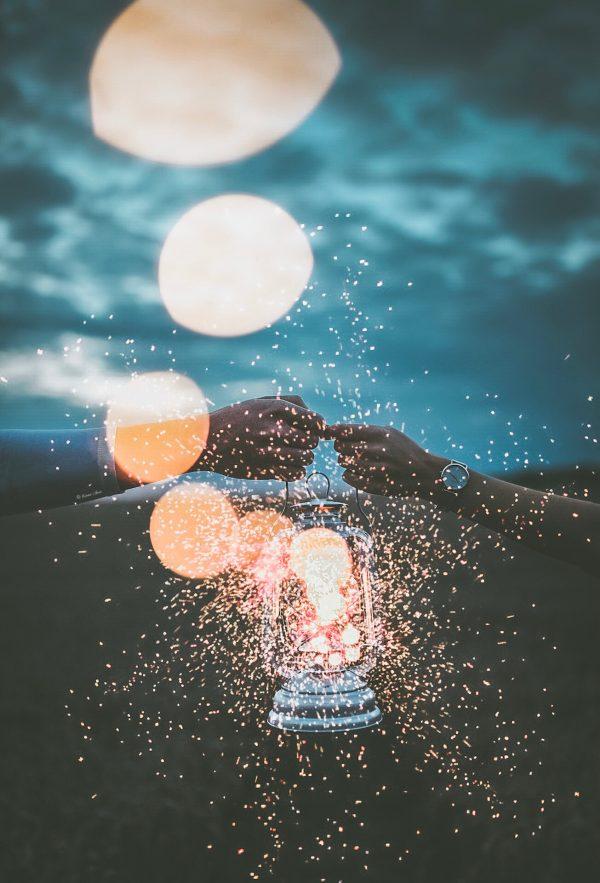 hands holding a light