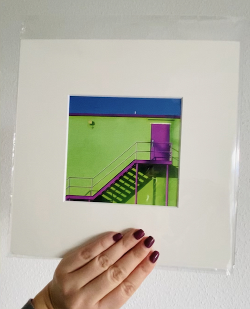 hand holding artwork with window mount